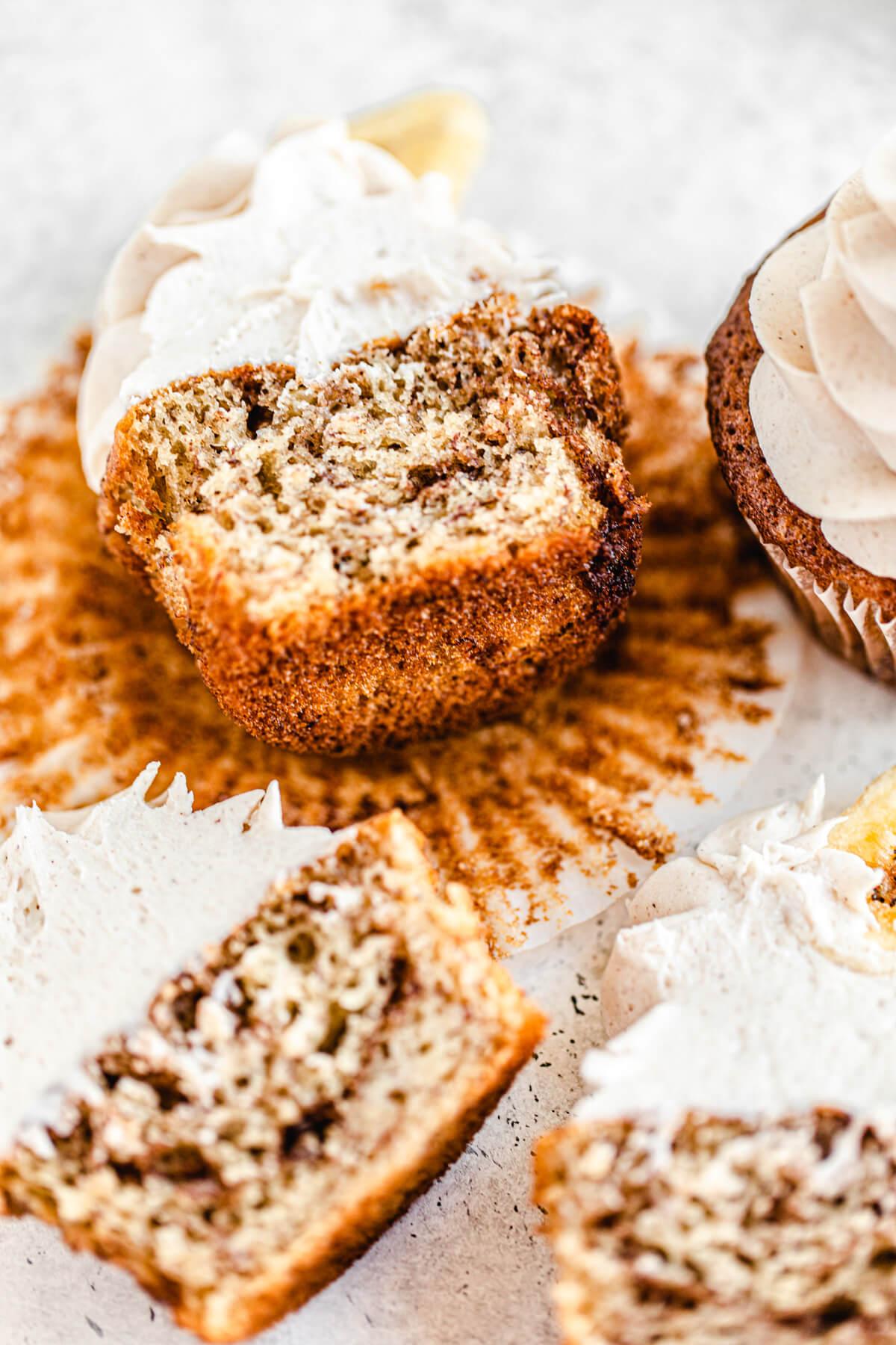 close up of multiple halved cinnamon swirl cupcakes