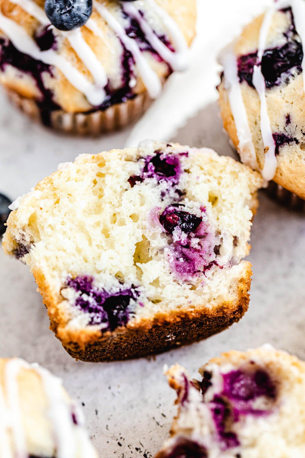 close up of halved blueberry muffin