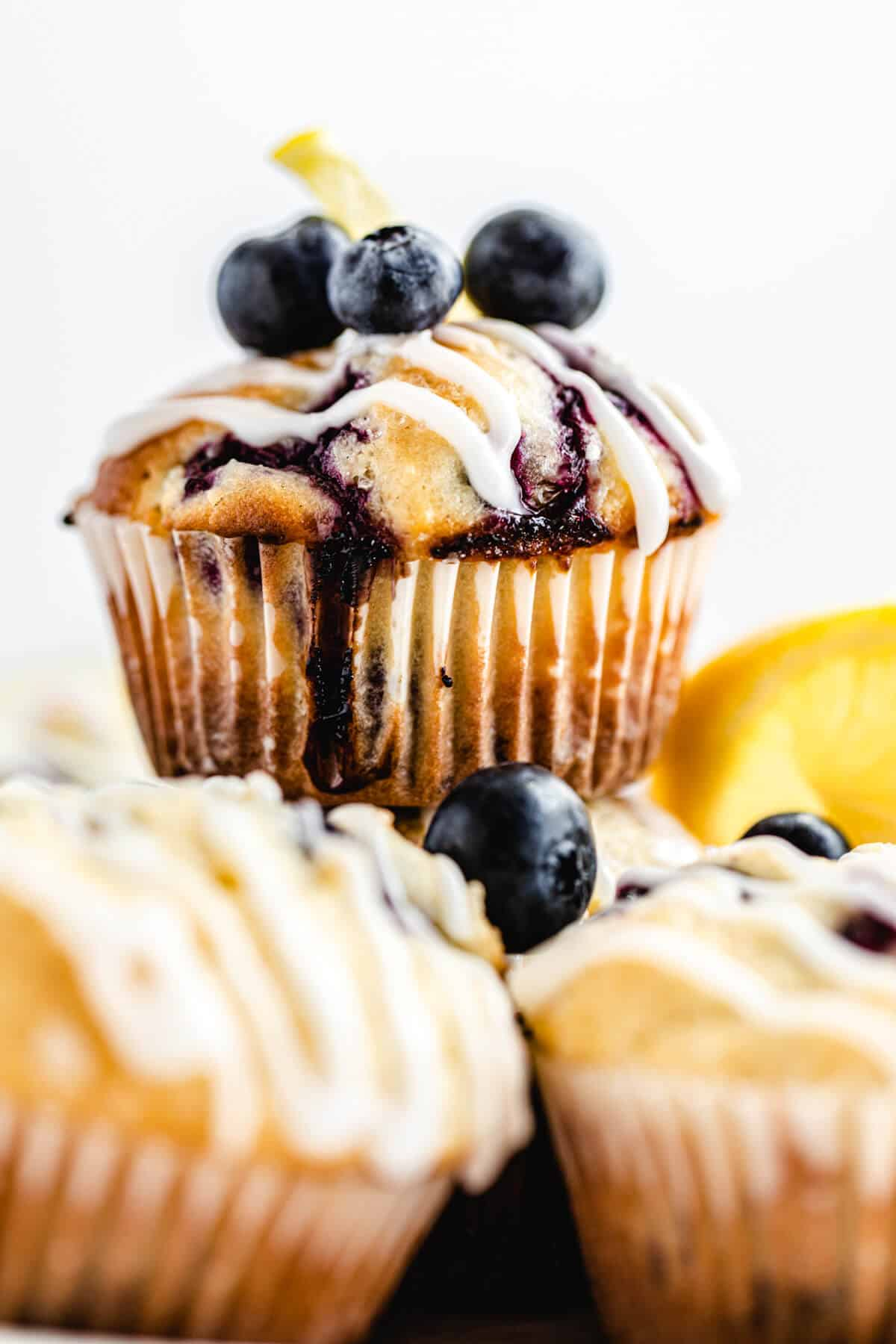 close up of blueberry muffin on top of other muffins