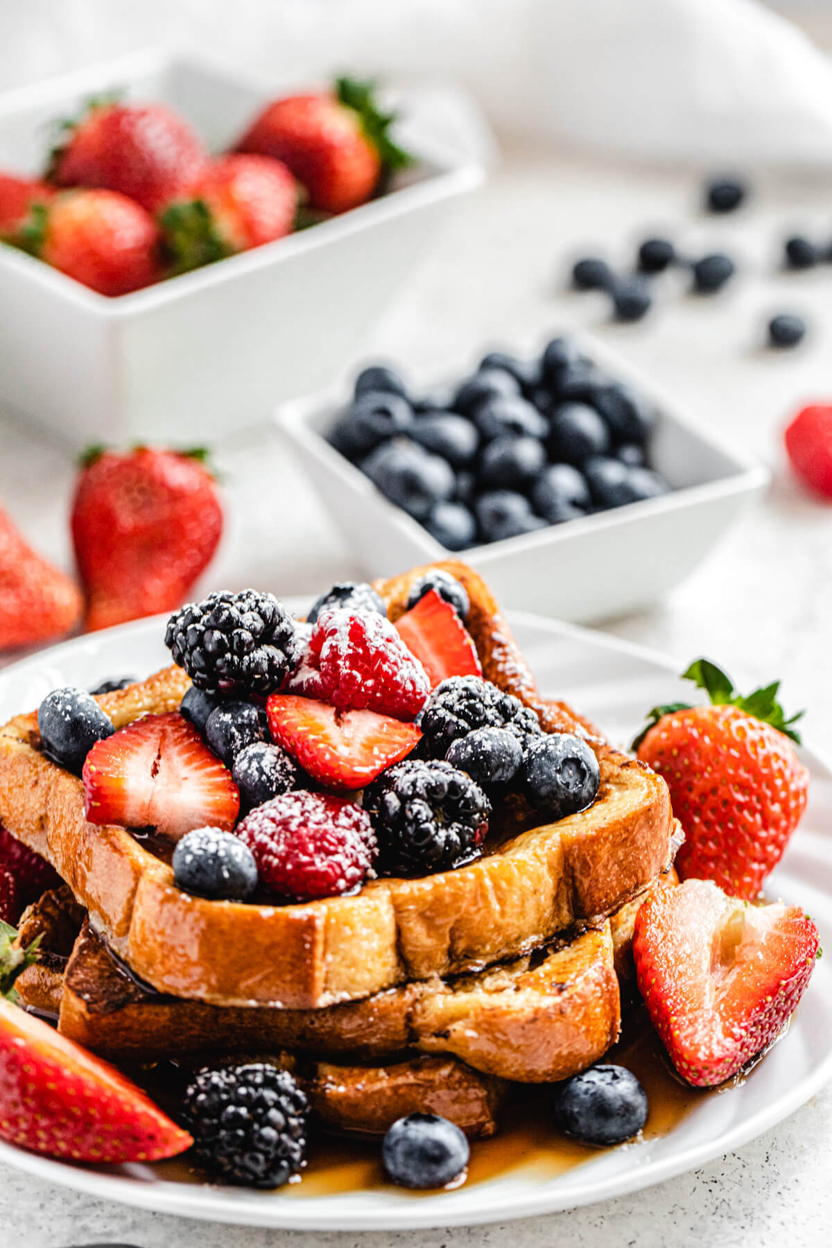 French toast topped with berries and icing sugar