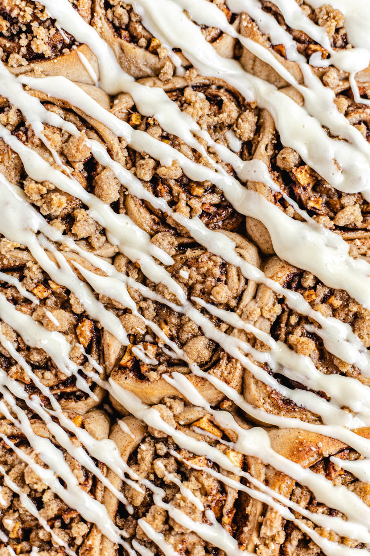 close up of cinnamon rolls with cream cheese drizzle