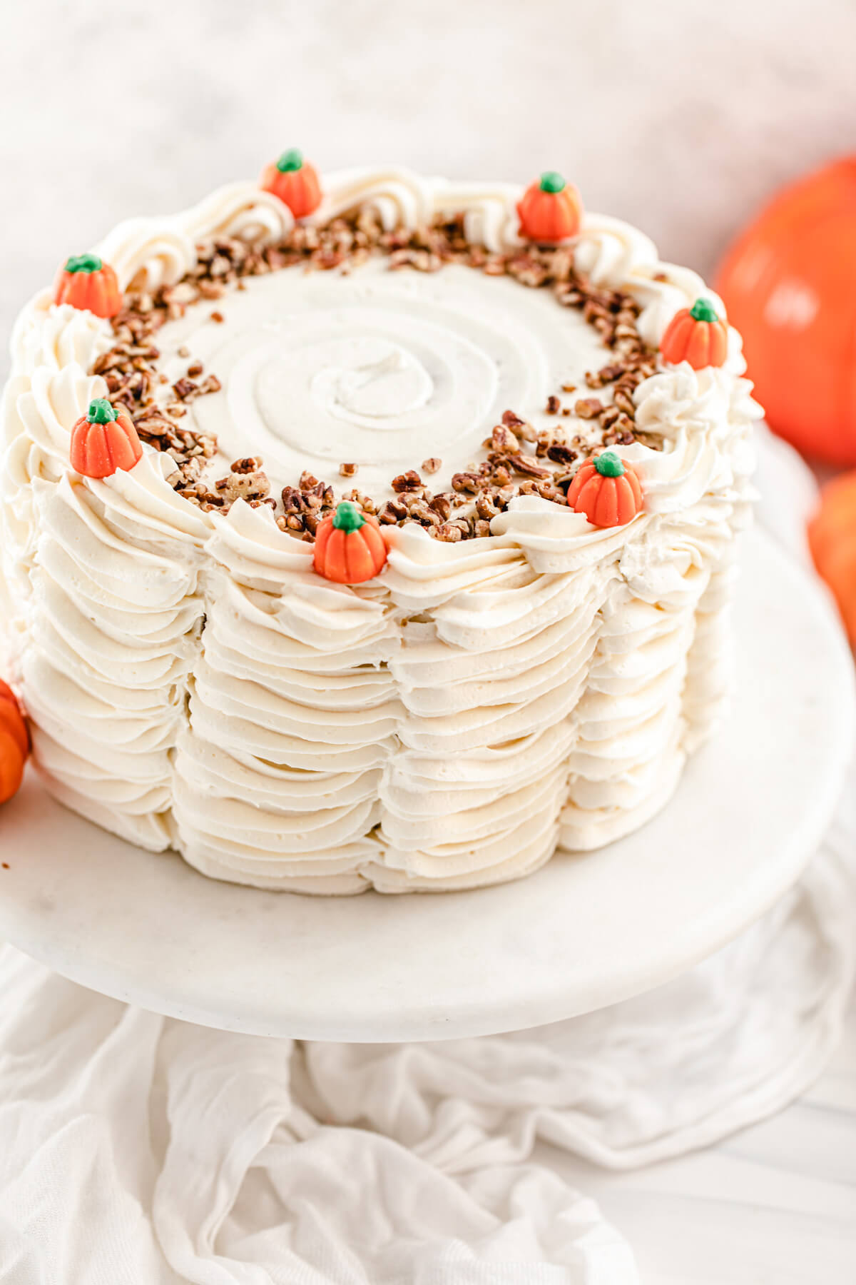 pumpkin candy topped cake on a marble cake stand