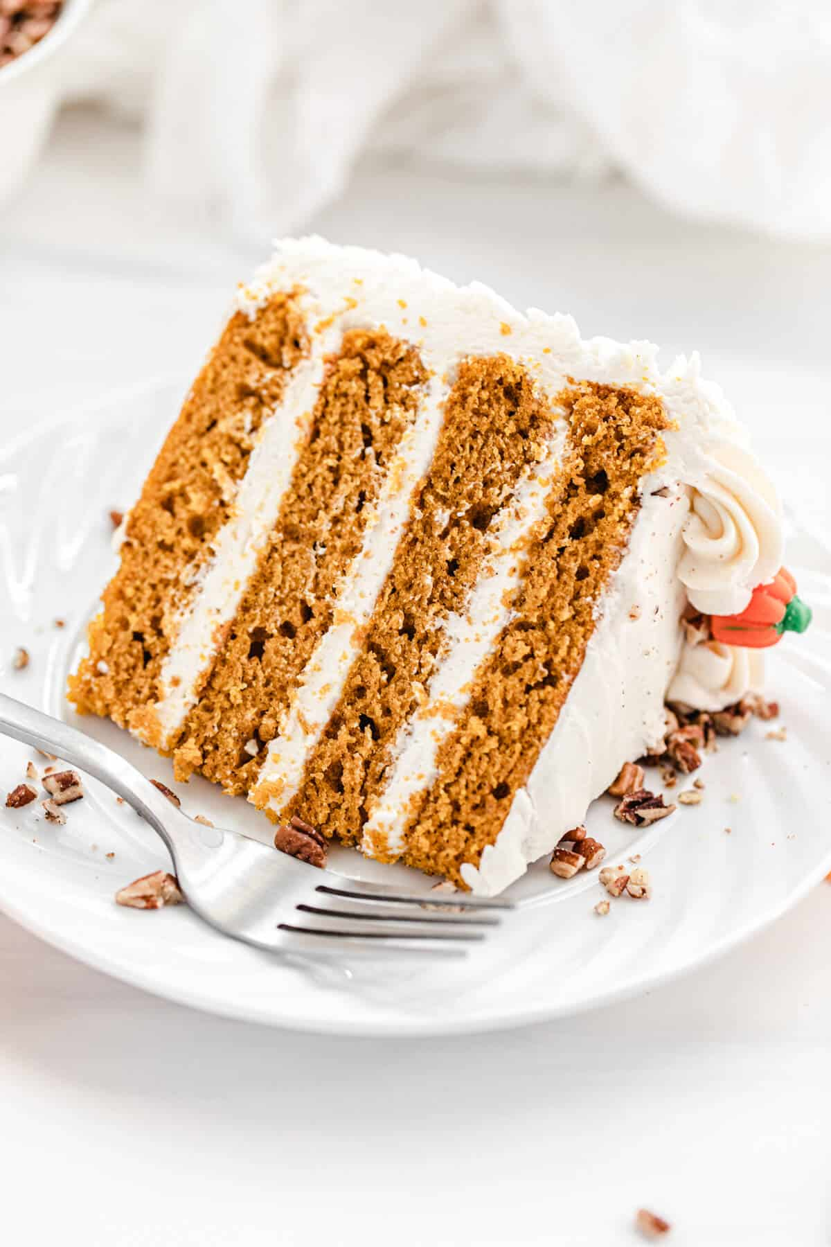 slice of pumpkin cake on a white plate