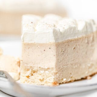 close up of eggnog cheesecake slice on a plate