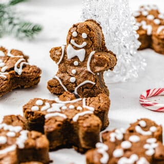 gingerbread man blondie propped up onto a clear glass Christmas tree