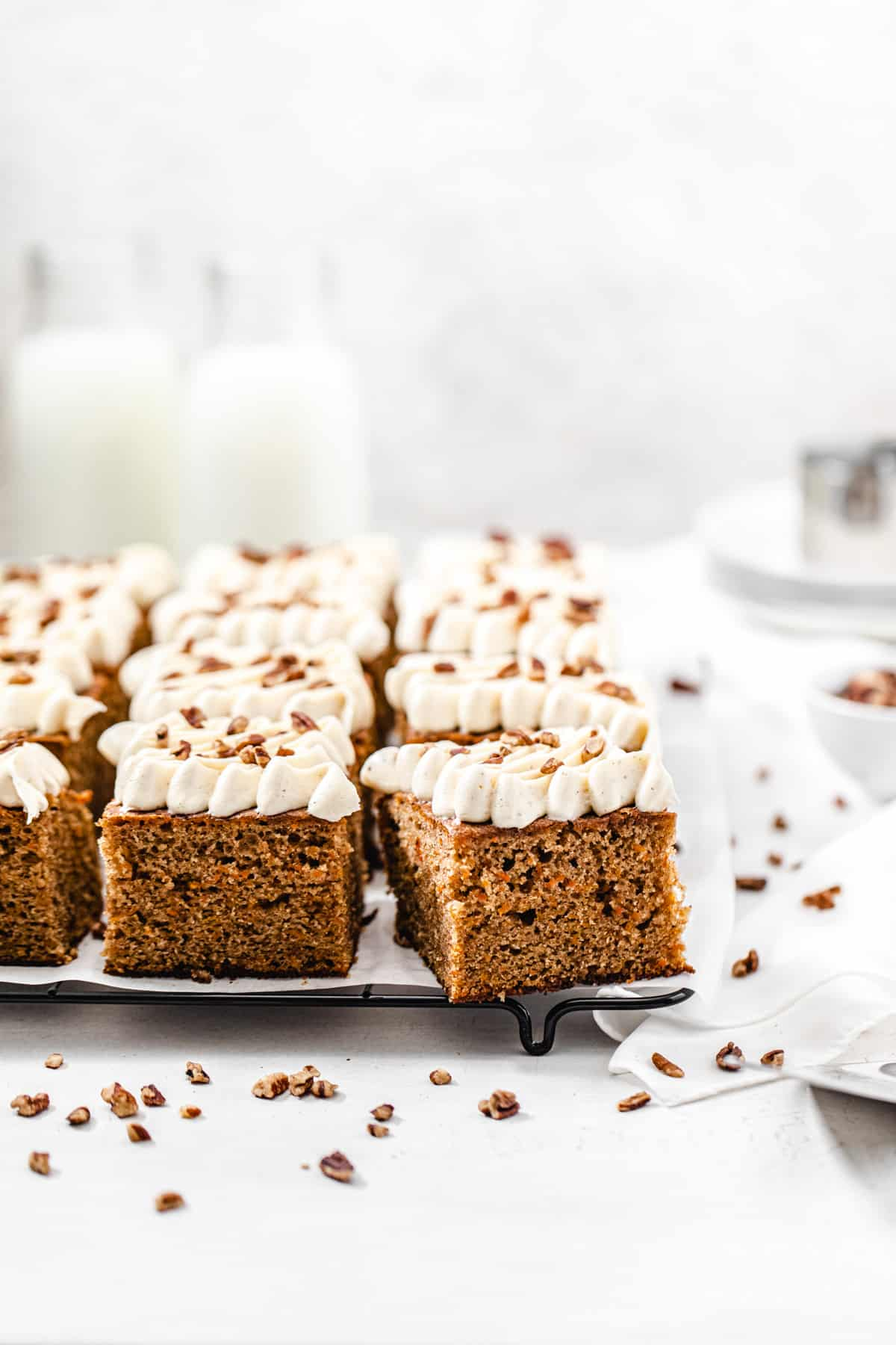 carrot cake slices on a parchment lined cooling rack