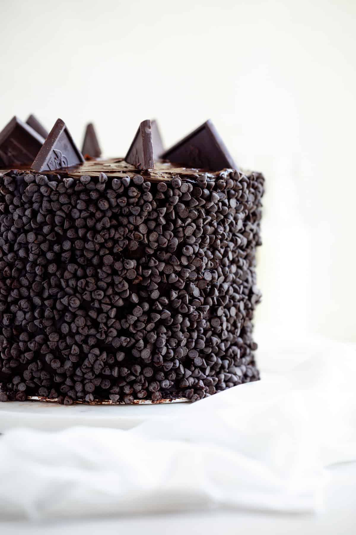 cake covered in mini chocolate chips on a cake board