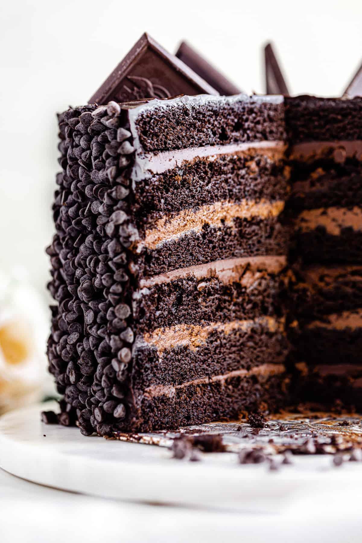 sliced open chocolate cake on a cake board