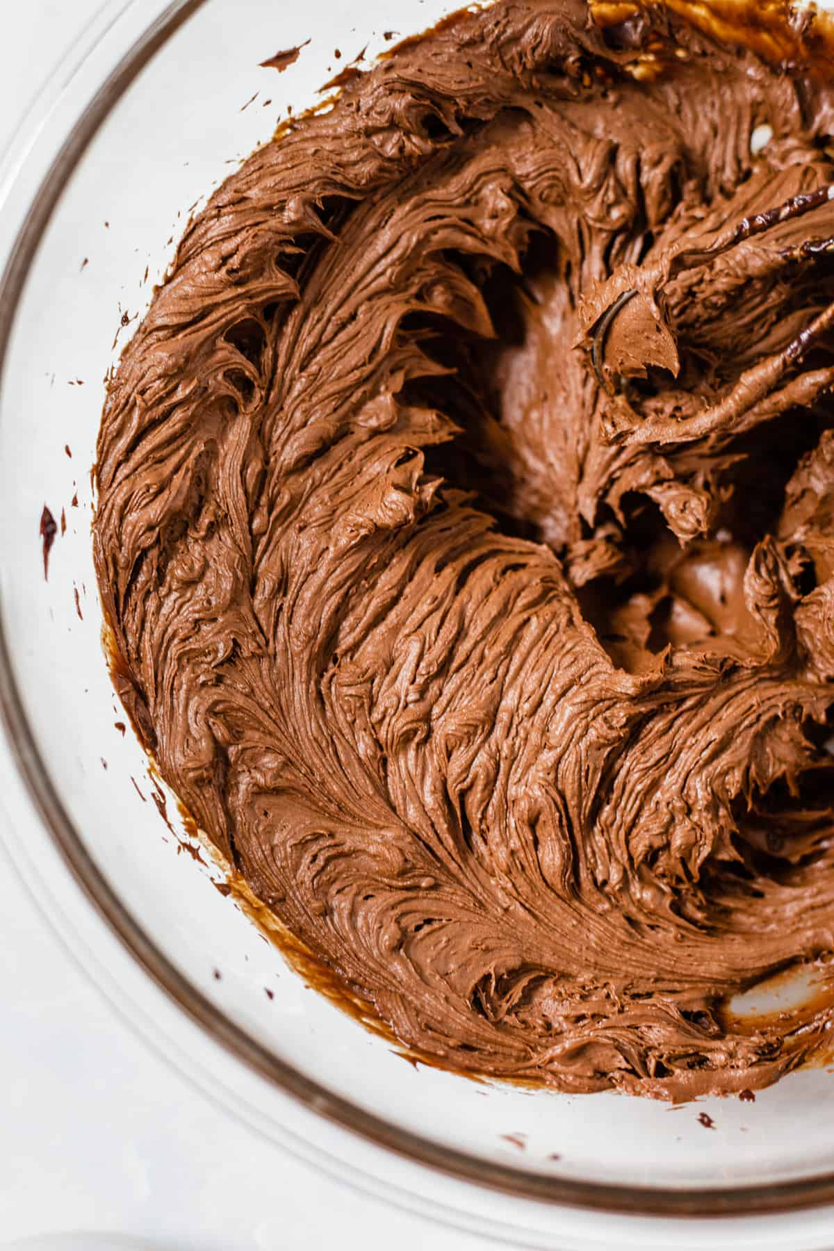 whipped chocolate ganache in a glass bowl